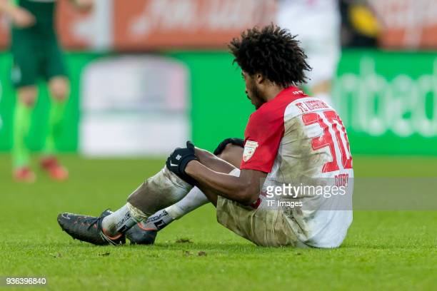 Caiuby Francisco da Silva of Augsburg on the ground during the Bundesliga match between FC Augsburg and SV Werder Bremen at WWKArena on March 17 2018...