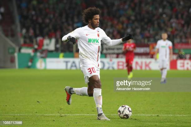 Caiuby Francisco da Silva of Augsburg runs with the ball during the DFB Cup match between FC Augsburg and 1 FSV Mainz 05 at WWKArena on October 30...