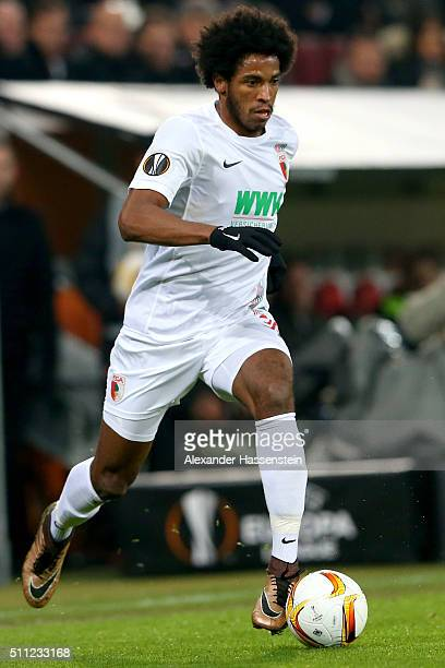 Caiuby Francisco da Silva of Augsburg runs with the ball during the UEFA Europa League round of 32 first leg match between FC Augsburg and Liverpool...