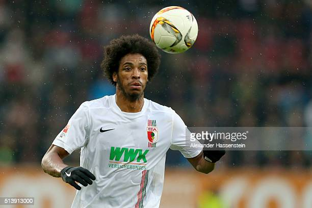 Caiuby Francisco da Silva of Augsburg runs with the ball during the Bundesliga match between FC Augsburg and Bayer Leverkusen at WWK Arena on March 5...