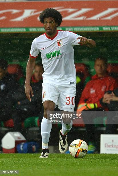 Caiuby Francisco da Silva of Augsburg runs with the ball during the Bundesiga match between FC Augsburg and Hamburger SV at SGL Arena on May 14 2016...