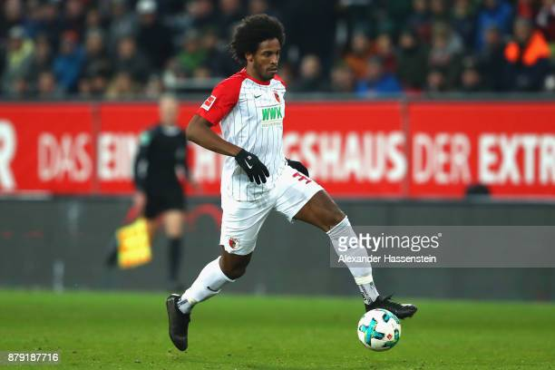 Caiuby Francisco da Silva of Augsburg runs with the ball during the Bundesliga match between FC Augsburg and VfL Wolfsburg at WWKArena on November 25...