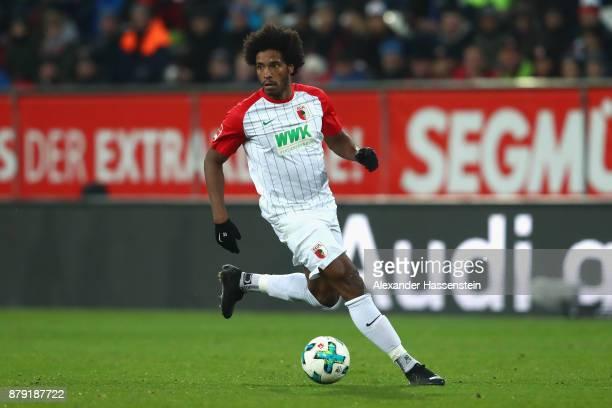 Caiuby Francisco da Silva of Augsburg runs with the ball during the Bundesliga match between FC Augsburg and VfL Wolfsburg at WWKArena on November 25...