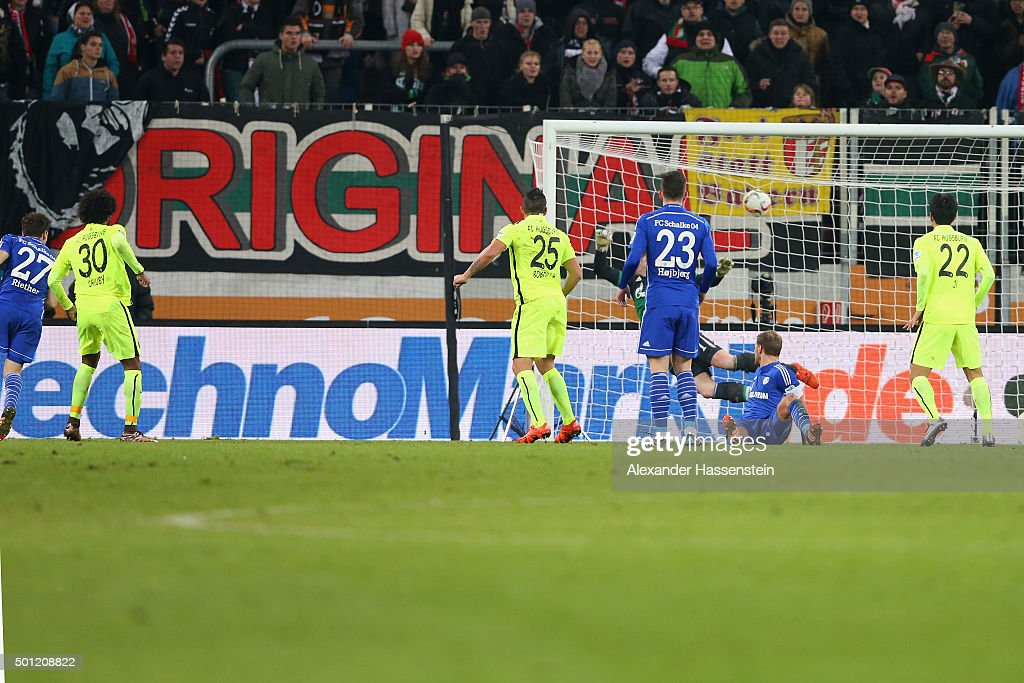 Caiuby Francisco da Silva (2nd L) of Augsburg scores the winning goal during the Bundesliga match between FC Augsburg and FC Schalke 04 at WWK Arena on December 13, 2015 in Augsburg, Germany.