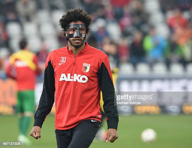 Caiuby Francisco da Silva of FC Augsburg wears protection mask during warmup before the Bundesliga match between SC Freiburg and FC Augsburg at...
