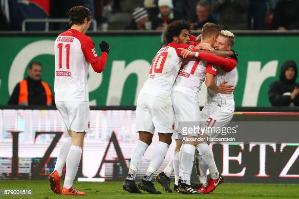 Caiuby of Augsburg Alfred Finnbogason of Augsburg and Philipp Max of Augsburg celebrate after Alfred Finnbogason of Augsburg scorned a goal to make...