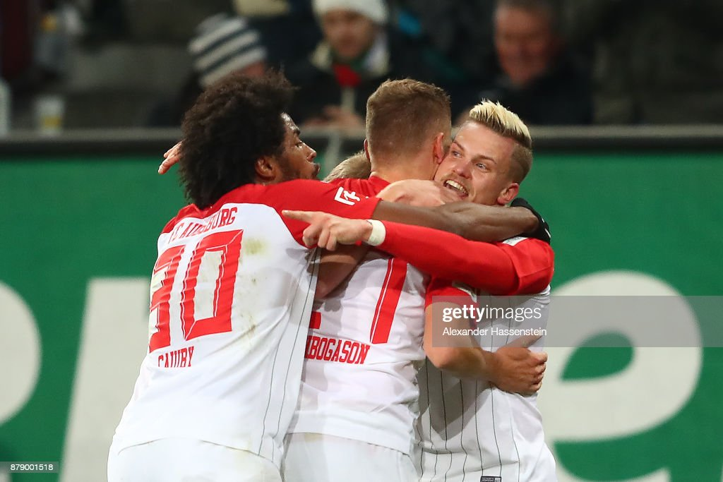 Caiuby of Augsburg, Alfred Finnbogason of Augsburg and Philipp Max of Augsburg) celebrate after Alfred Finnbogason of Augsburg scorned a goal to make it 2:1 during the Bundesliga match between FC Augsburg and VfL Wolfsburg at WWK-Arena on November 25, 2017 in Augsburg, Germany.