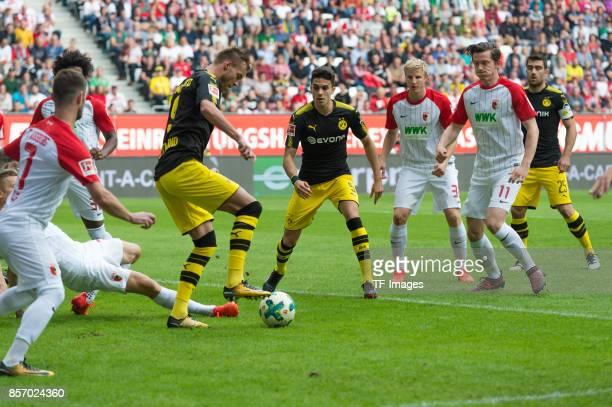 Caiuby of Augsburg Alfred Finnbogason of Augsburg Marcel Heller of Augsburg Andrey Yarmolenko of Dortmund Marc Bartra of Dortmund battle for the ball...