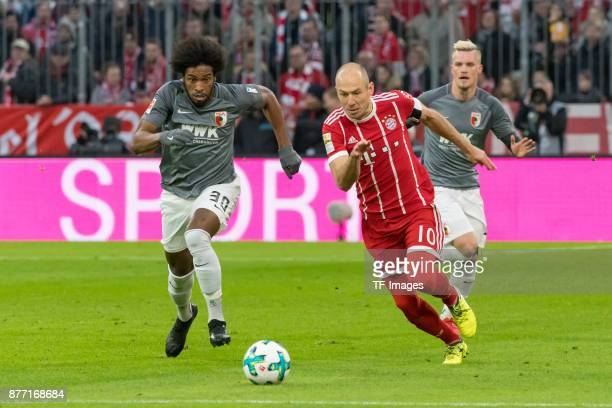 Caiuby of Augsburg and Arjen Robben of Bayern Muenchen battle for the ball during the Bundesliga match between FC Bayern Muenchen and FC Augsburg at...