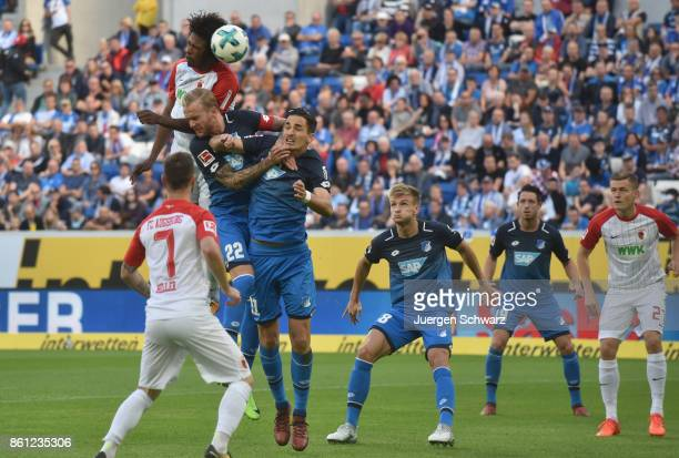 Caiuby of Augsburg and Kevin Vogt of Hoffenheim jump for the ball during the Bundesliga match between TSG 1899 Hoffenheim and FC Augsburg at Wirsol...