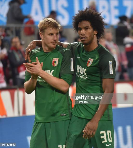 Caiuby of Augsburg and Martin Hinteregger look on after the Bundesliga match between 1 FC Koeln and FC Augsburg at RheinEnergieStadion on January 27...