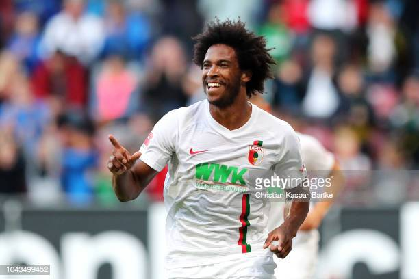 Caiuby of Augsburg celebrates after scoring his team's first goal during the Bundesliga match between FC Augsburg and SportClub Freiburg at WWKArena...
