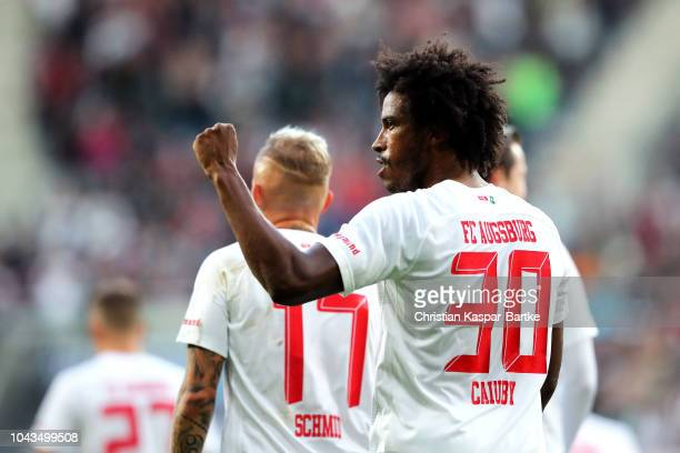 Caiuby of Augsburg celebrates after scoring his team's first goal during the Bundesliga match between FC Augsburg and Sport-Club Freiburg at...