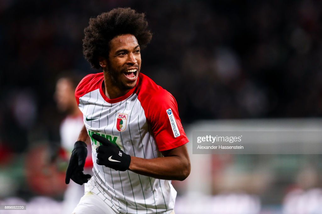 Caiuby #30 of Augsburg celebrates after scoring his team's first goal to make it 1-0 during the Bundesliga match between FC Augsburg and Hertha BSC at WWK-Arena on December 10, 2017 in Augsburg, Germany.