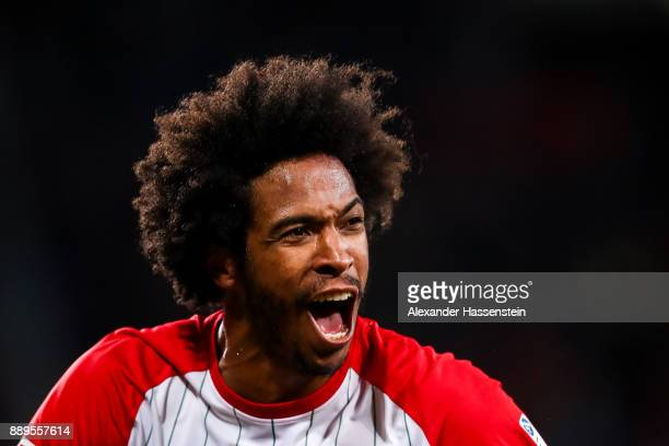 Caiuby of Augsburg celebrates after scoring his team's first goal to make it 10 during the Bundesliga match between FC Augsburg and Hertha BSC at...