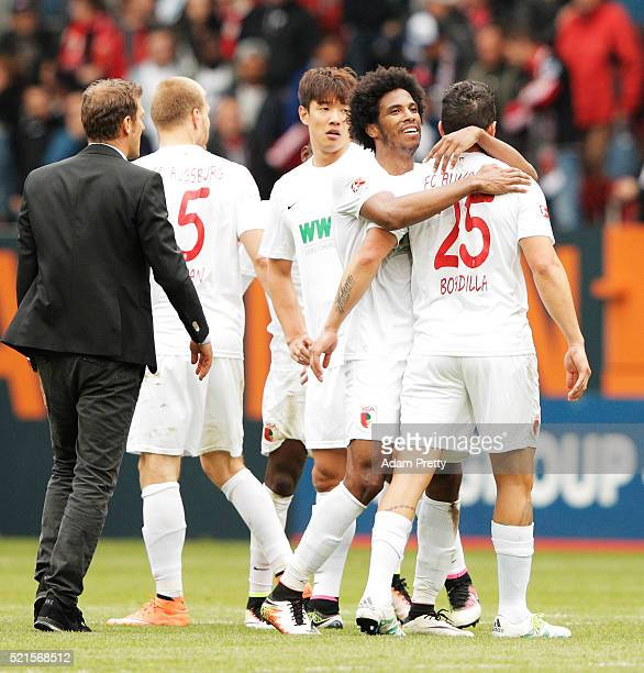 Caiuby of Augsburg celebrates victory with Raul Bobadilla of Augsburg after the Bundesliga match between FC Augsburg and VfB Stuttgart at WWK Arena...