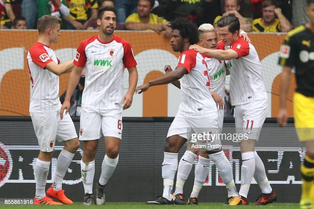 Caiuby of Augsburg celebrates with his team after he scored his teams first goal to make it 11 during the Bundesliga match between FC Augsburg and...
