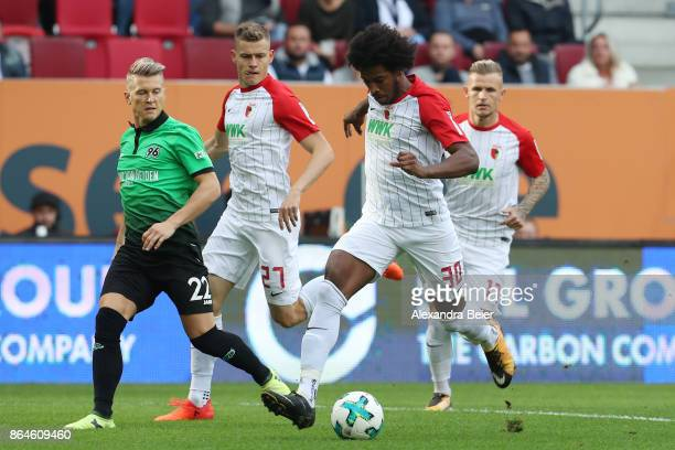 Caiuby of Augsburg runs with the ball during the Bundesliga match between FC Augsburg and Hannover 96 at WWKArena on October 21 2017 in Augsburg...