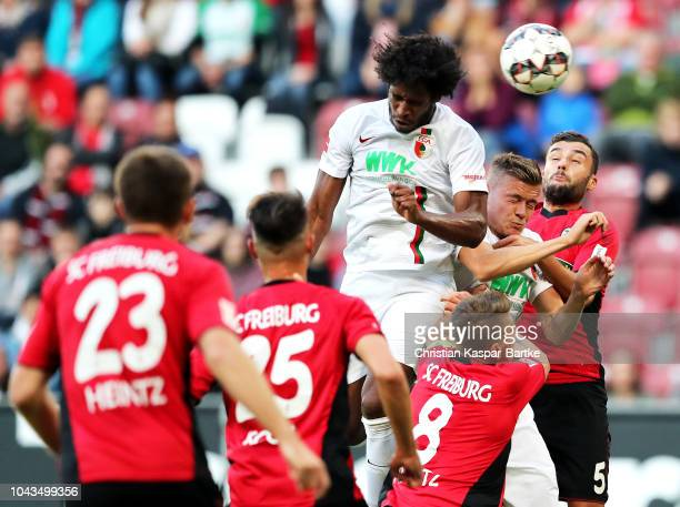 Caiuby of Augsburg scores his team's first goal during the Bundesliga match between FC Augsburg and SportClub Freiburg at WWKArena on September 30...