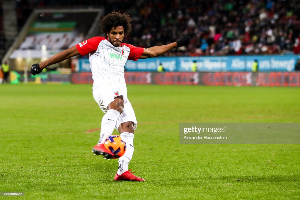 Caiuby #30 of Augsburg scores his team's first goal to make it 1-0 during the Bundesliga match between FC Augsburg and Hertha BSC at WWK-Arena on December 10, 2017 in Augsburg, Germany.