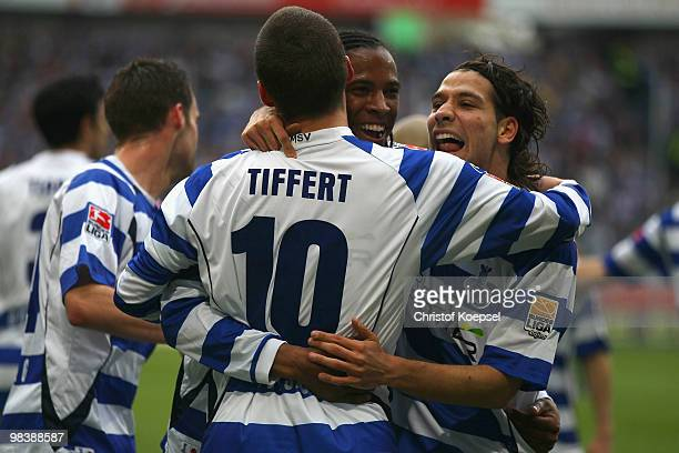 Caiuby of Duisburg celebrates the first goal with Christian Tiffert and Olcay Sahan during the Second Bundesliga match between MSV Duisburg and SpVgg...