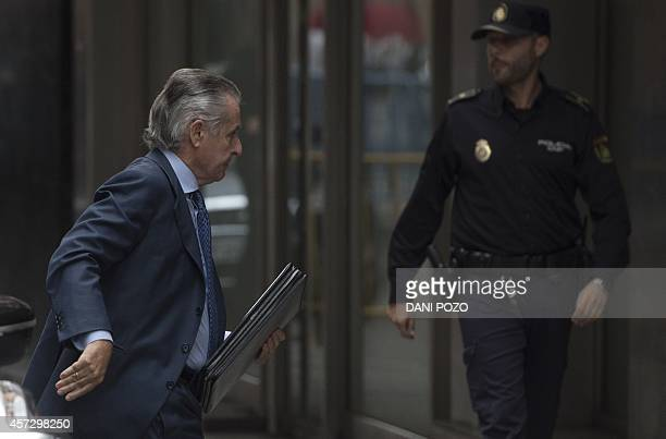 Caja Madrid's former head Miguel Blesa arrives for a hearing in Madrid on October 16 2014 accused of spending sprees with a company credit card while...