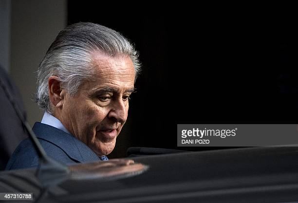 Caja Madrid's former head Miguel Blesa leaves a hearing in Madrid on October 16 2014 accused of spending sprees with a company credit card while he...