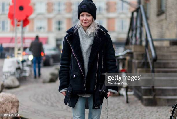 Cajsa Asplund wearing black Acne beanie black jacket denim jeans during the Copenhagen Fashion Week Autumn/Winter 17 on February 2 2017 in Copenhagen...