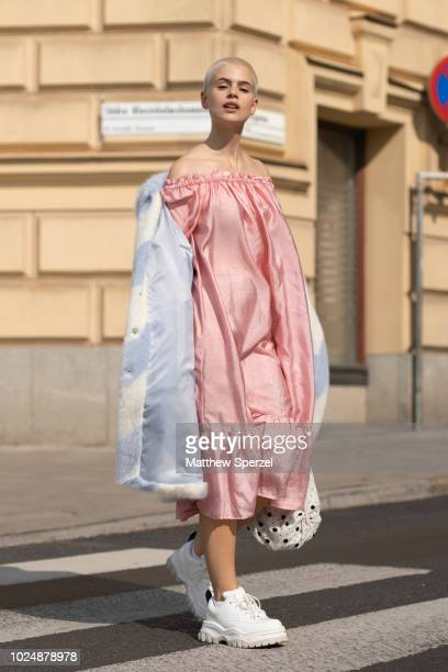 Cajsa Wessberg is seen on the street during Fashion Week Stockholm wearing a pink dress with blue/white fur coat and white sneakers on August 28 2018...