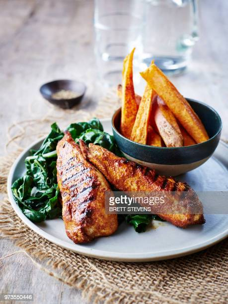 Cajun chicken with chard and sweet potato chips