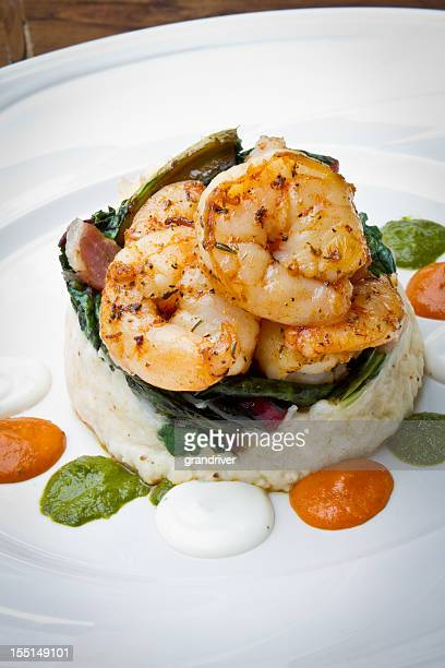 cajun jumbo shrimp and grits - shrimp and grits stock photos and pictures