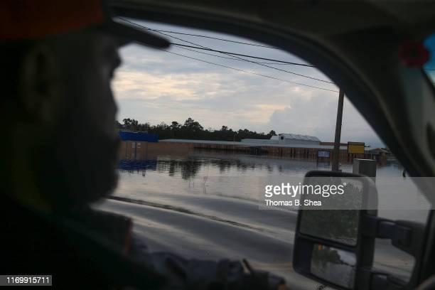 Cajun Navy volunteer drives past a flooded school on highway 124 on September 20 2019 in Beaumont Texas Gov Greg Abbott has declared much of...