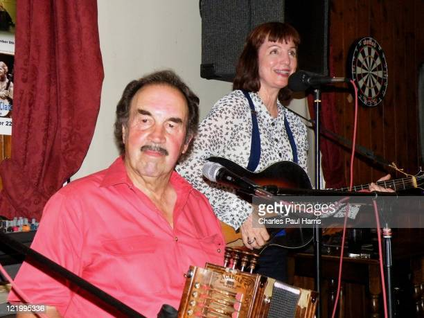 Cajun performers Marc and Ann Savoy of the Savoy Family Band perform at the Royal Oak Pub on July 28, 2011 in Lewes, England.