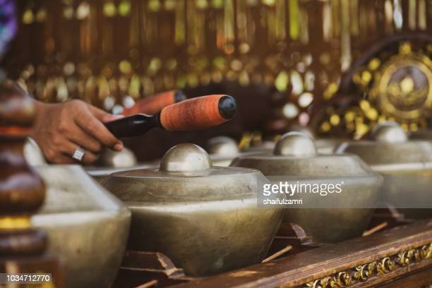 'Cak Lempong' - a small kettle gong which gives its name to an ensemble of four or five talempong, which is present in the different configurations of the Nobat, a ceremonial traditional orchestra.