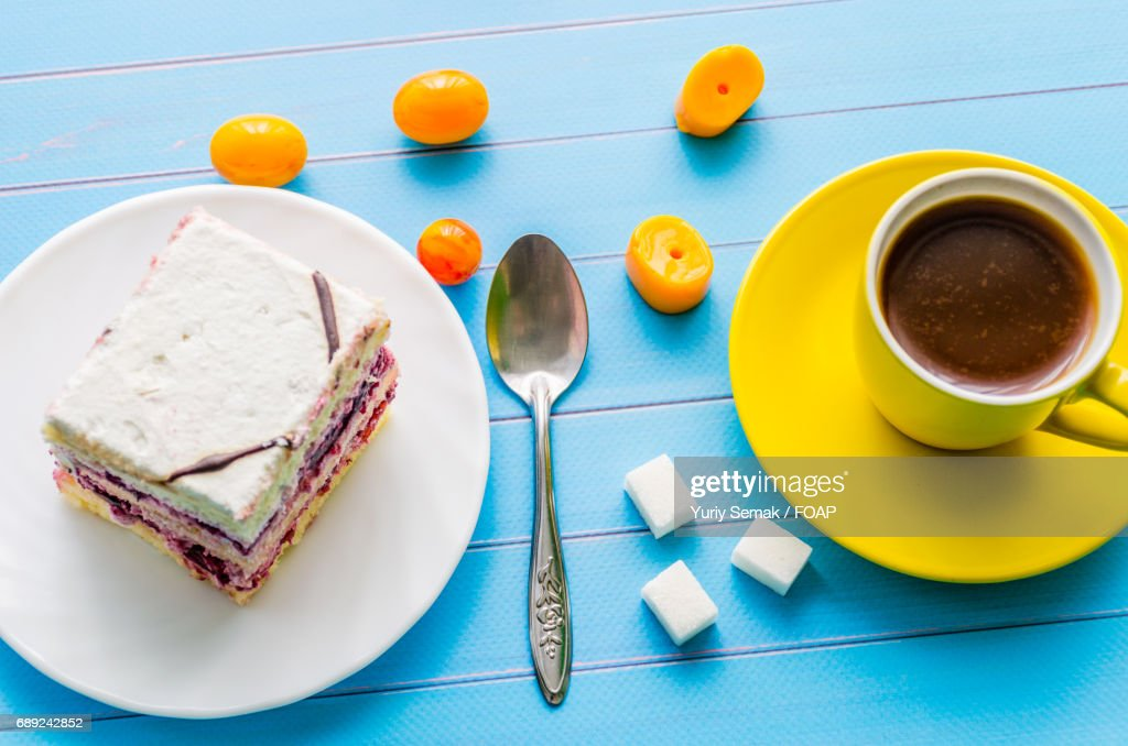 Cake and coffee for breakfast : Stock Photo
