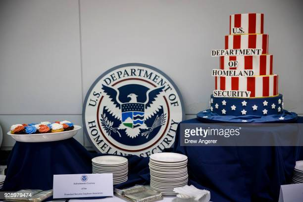 Cake and cupcakes sit on a table during an event to mark the 15th anniversary of the Department of Homeland Security March 1 2018 in Washington DC...