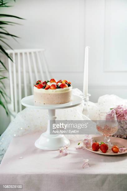Cake And Wine On Table During Celebration