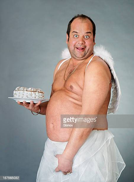 cake angel - male angel stock photos and pictures