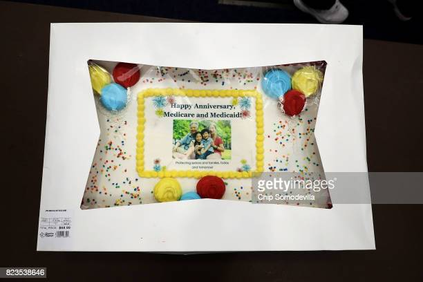 A cake arrives for an event to celebrate the 52nd anniversary of Medicaid and Medicare in the House Visitors Center at the US Capitol July 27 2017 in...
