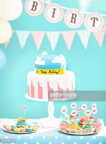 Cake, cookies and cupcakes at birthday party