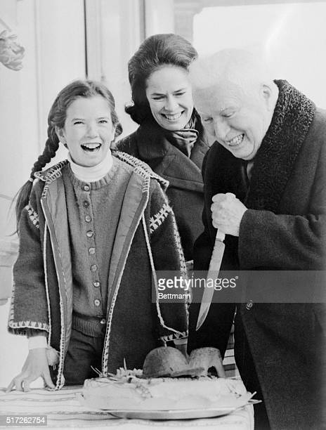 Cake Cutter Vevey Switzerland Charles Chaplin gets some help from his wife Oona center and the couple's 11yearold daughter Jane as he menaces his...