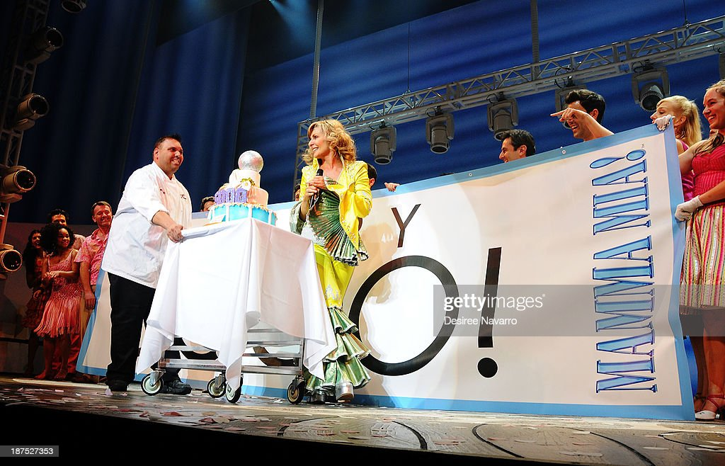 Cake decorator/TV personality Frankie Amato and Judy McLane bring out the anniversary cake on stage during curtain call at the 5,000 performance celebration of 'Mamma Mia!' on Broadway at Broadhurst Theatre on November 9, 2013 in New York City.