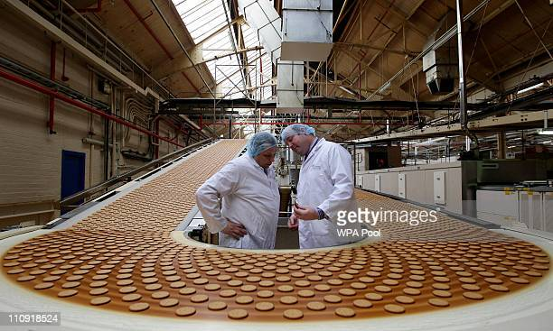 Cake Design and Development Head chef Paul Courtney and Manufacturing Manager Tom Kilcourse perform a quality check on biscuits on the production...