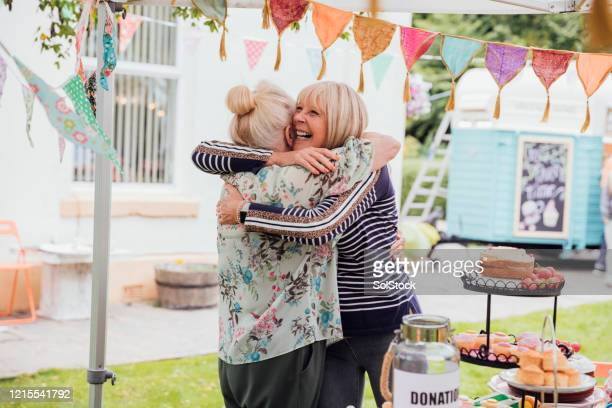 cake hugs - gala stock pictures, royalty-free photos & images