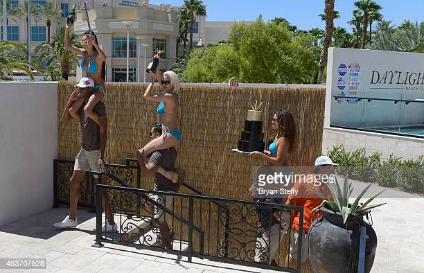 A cake is presented to the BKB Knockout Girls during the inaugural fight celebration at Daylight Beach Club at the Mandalay Bay Resort and Casino on...