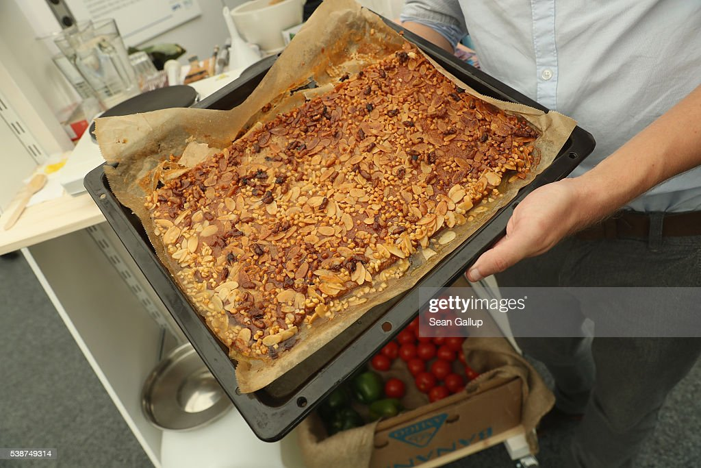 A cake made with honey and almonds and topped with roasted male bees awaits visitors at a stand at an environmental fair at Schloss Bellevue palace on June 8, 2016 in Berlin, Germany. Insects as a widespread source of food for humans is gaining worldwide as a palatable alternative solution to feeding an ever-growing human population.