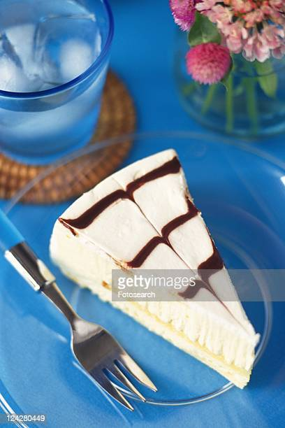 Cake on the Plate Served with Glass of Water, High Angle View