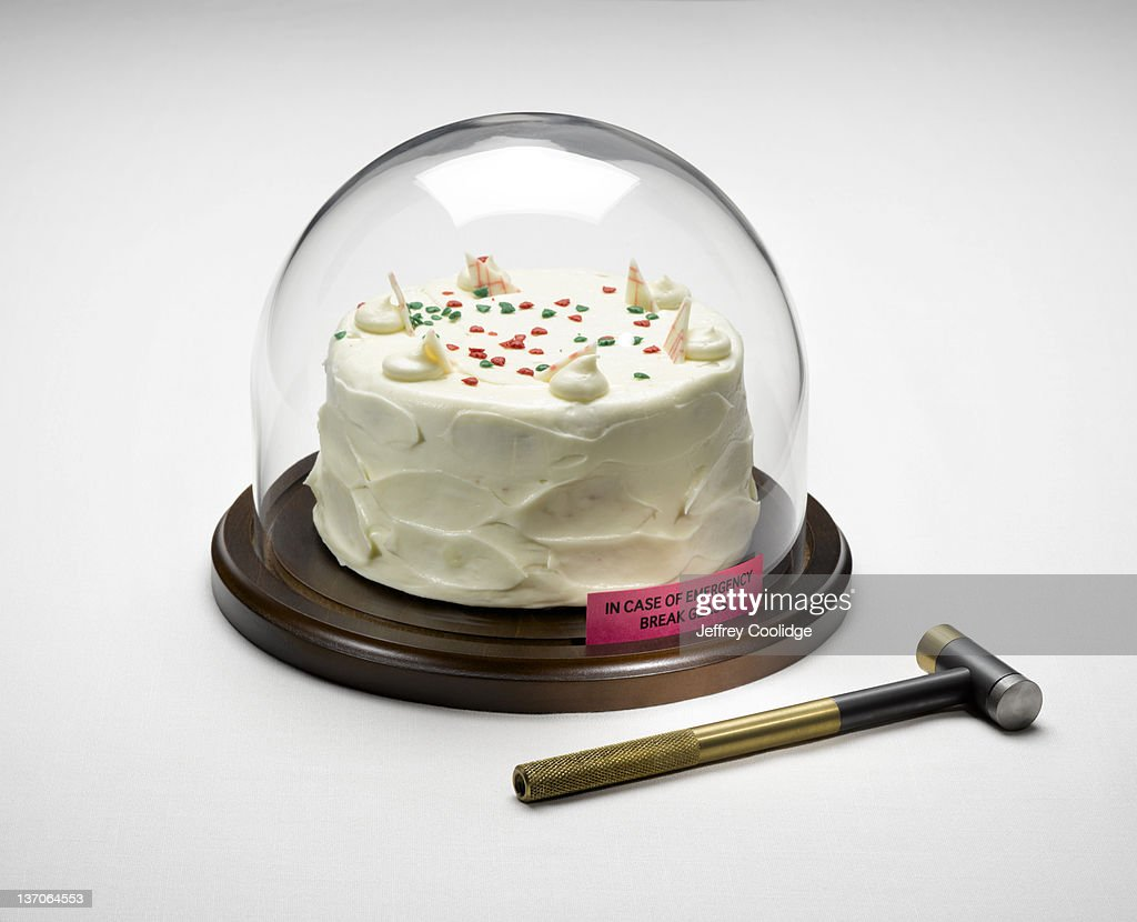 Cake Under Glass With Hammer Stock Photo