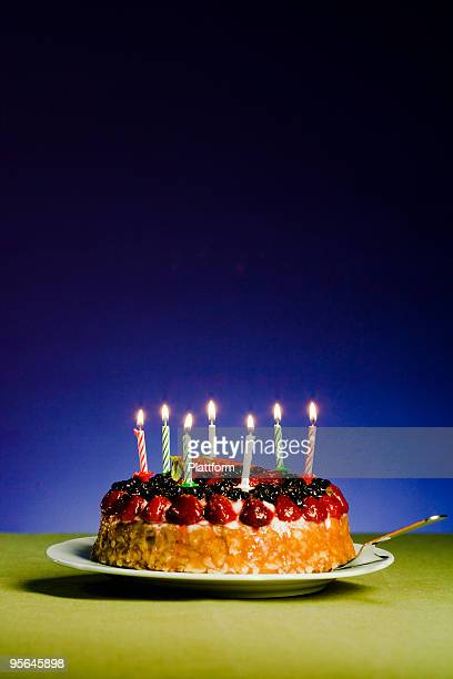 a cake with candles. - fruit cake stock pictures, royalty-free photos & images