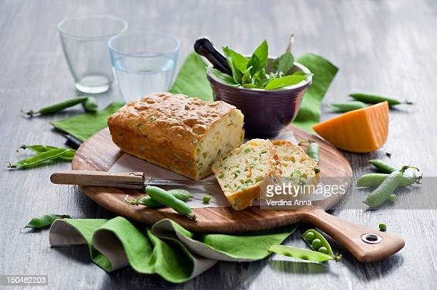 cake with cheese and green peas - anna verdina stock photos and pictures